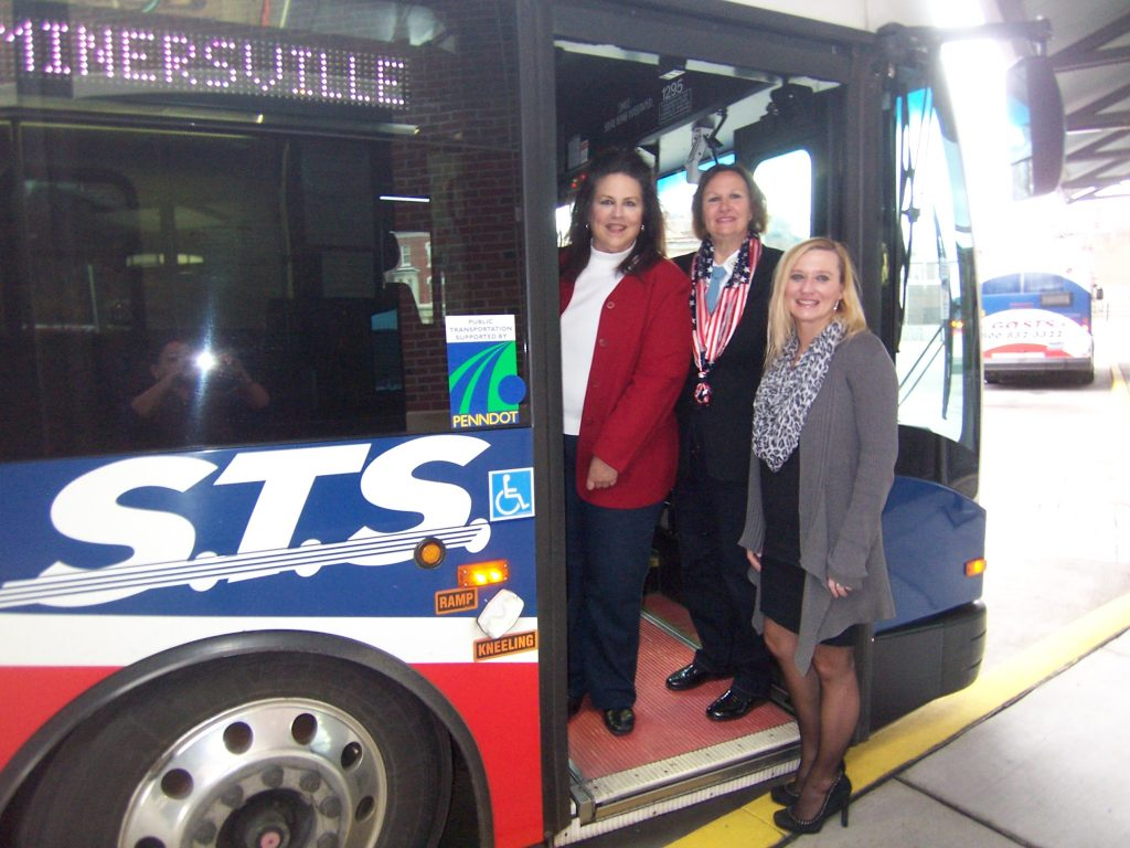 Welcoming veterans aboard the Minersville fixed route bus for their FREE ride in honor of Veterans Day are: (L) to (R): Joan Breslin, Marketing and Service Support Coordinator; Theresa Gaffney, Schuylkill County Register of Wills, 6 yrs US Army Reserve Service; Rhonda Lomas-O'Donnell, STS Human Resources Manager
